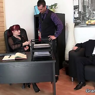 office hairy mature boss swallows two cocks at once