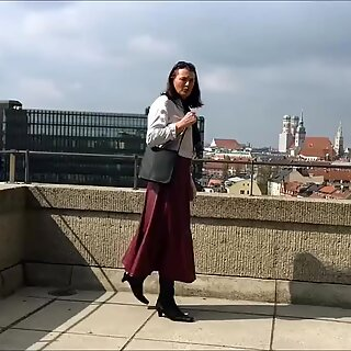 Long leather skirt outdoors
